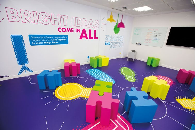 Ideas Exchange room, lightbulb graphics on floor and jigsaw-style furniture
