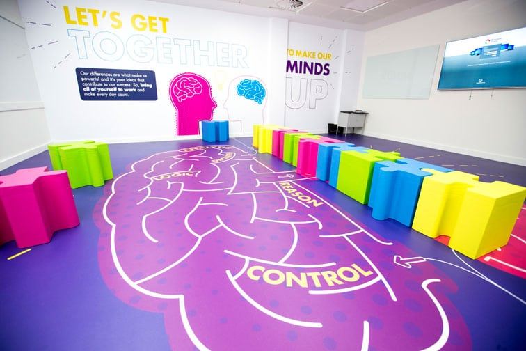 Ideas Exchange room, diagram of brain on floor and jigsaw-style furniture