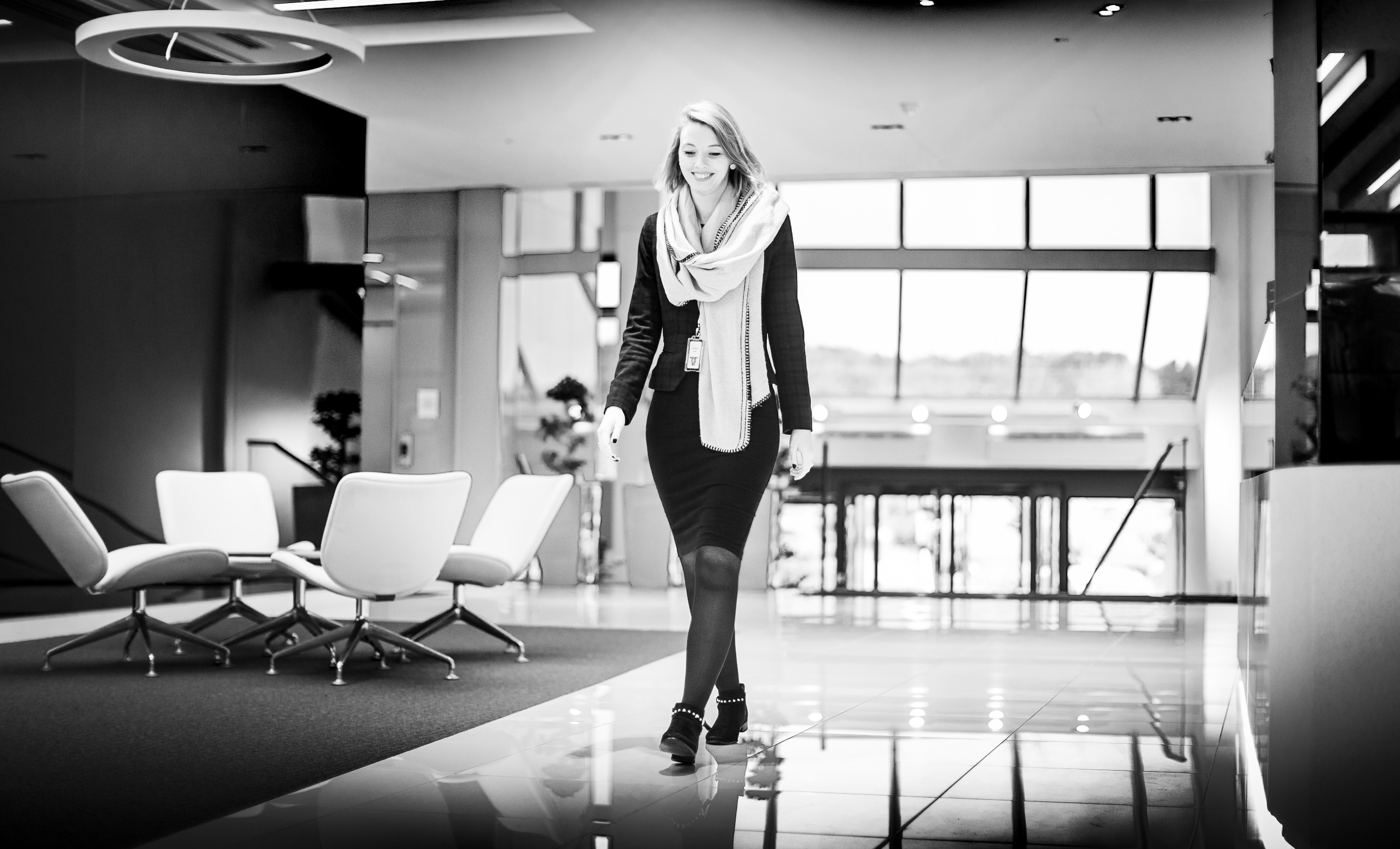 Woman walking across an office space at Honda