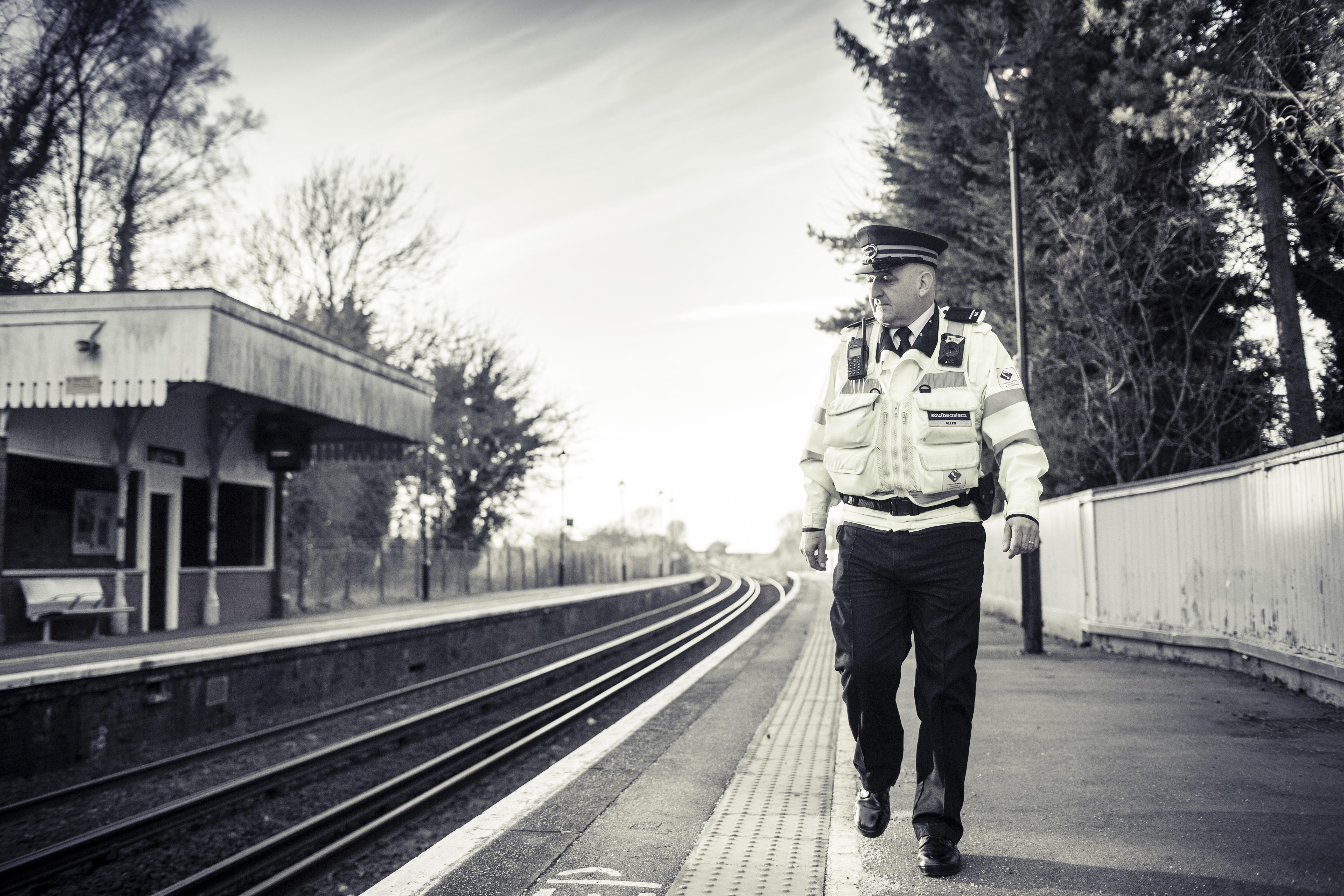 Southeastern Revenue Protection Officer walking along station platform