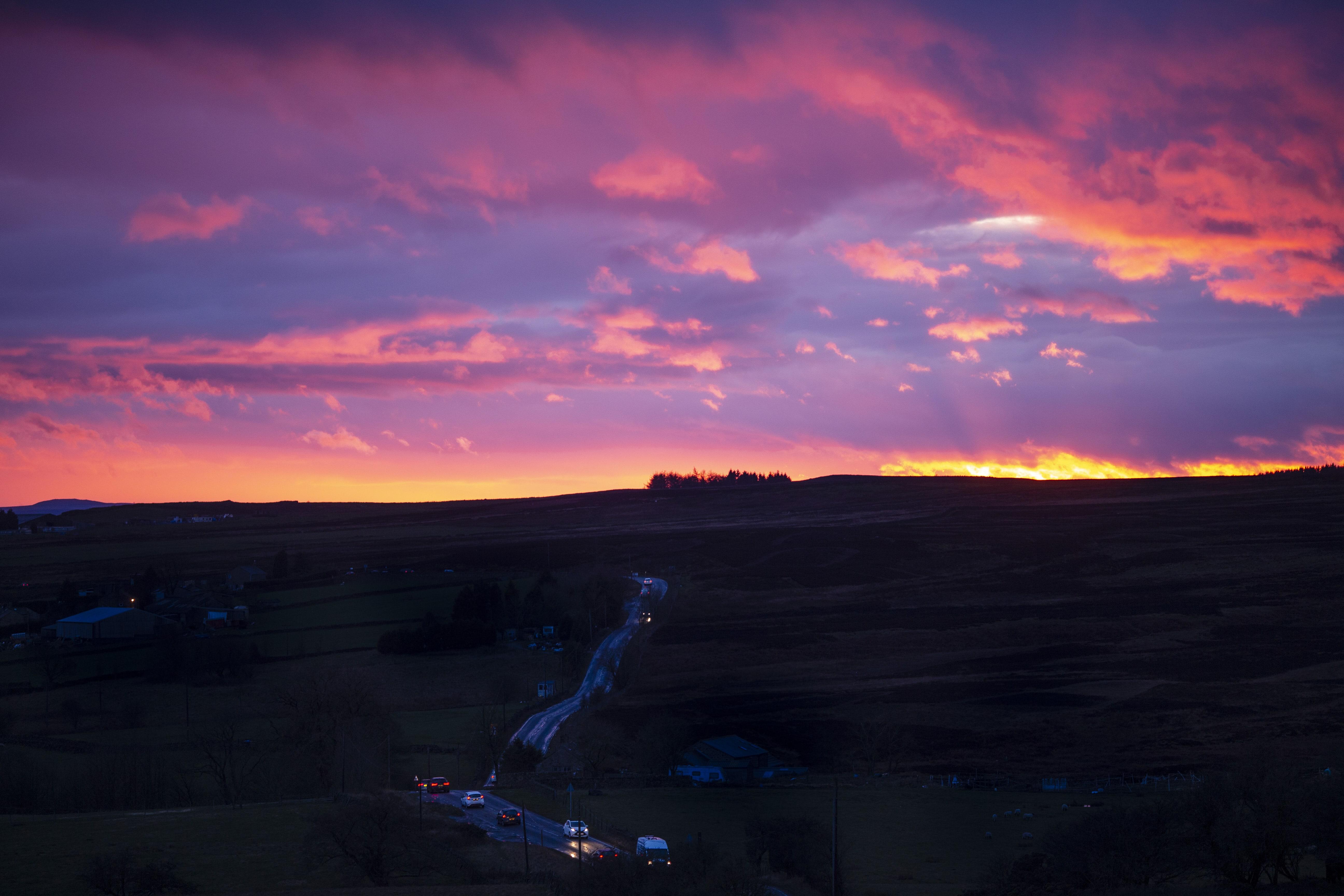 Sunset across moor road