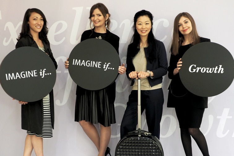 Colleagues from Air Astana and Words and Pictures holding discs with the words Imagine If Growth