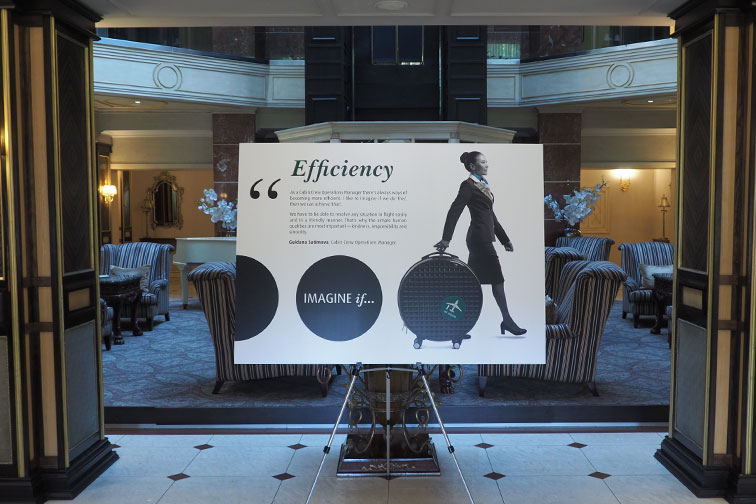 Imagine if Efficiency storyboard on a display stand in a hotel foyer