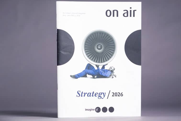 On Air Strategy 2026 brochure cover, with mechanic lying underneath a jet engine