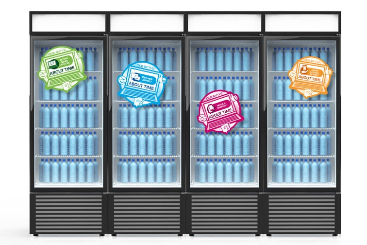 Four vending machines each displaying laptop graphic
