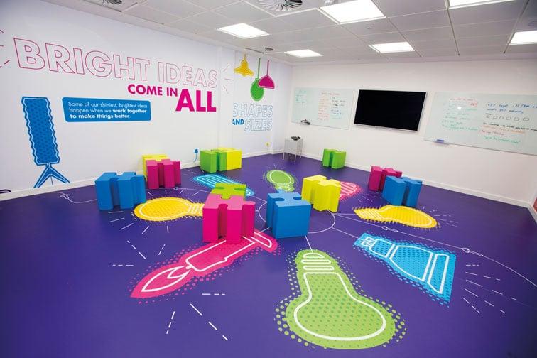 Ideas Lab, lightbulb graphics on floor, wall art, jigsaw-style furniture