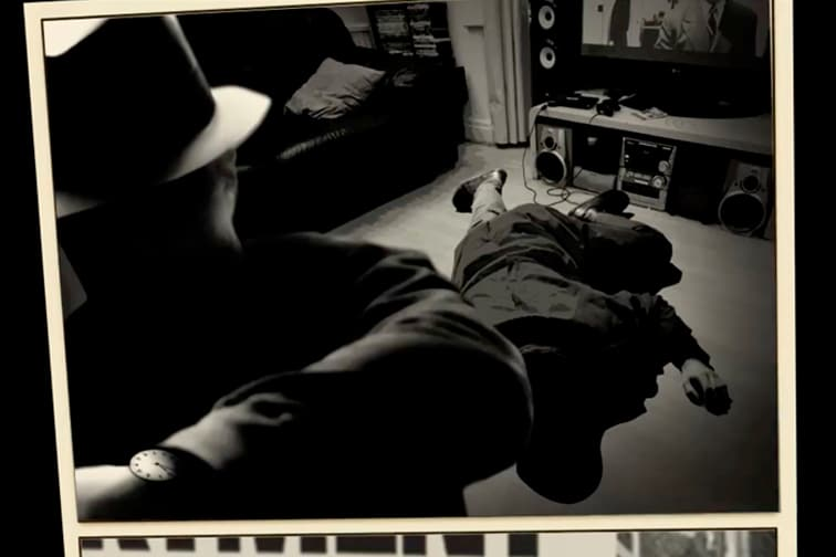 Body lying on floor and shadowy figure leaving the scene