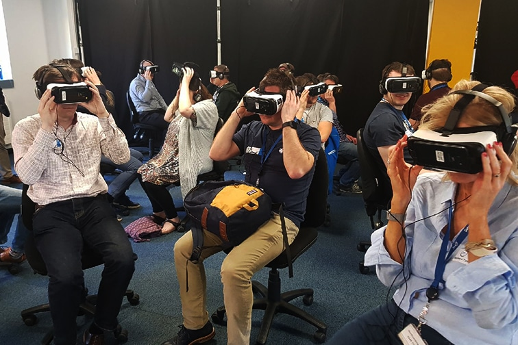 NWG colleagues looking through virtual reality headsets