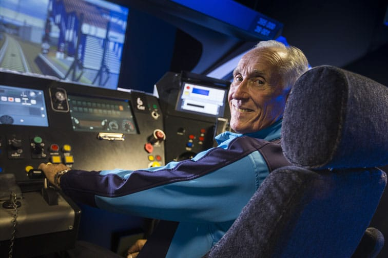 Smiling employee seated at a control panel