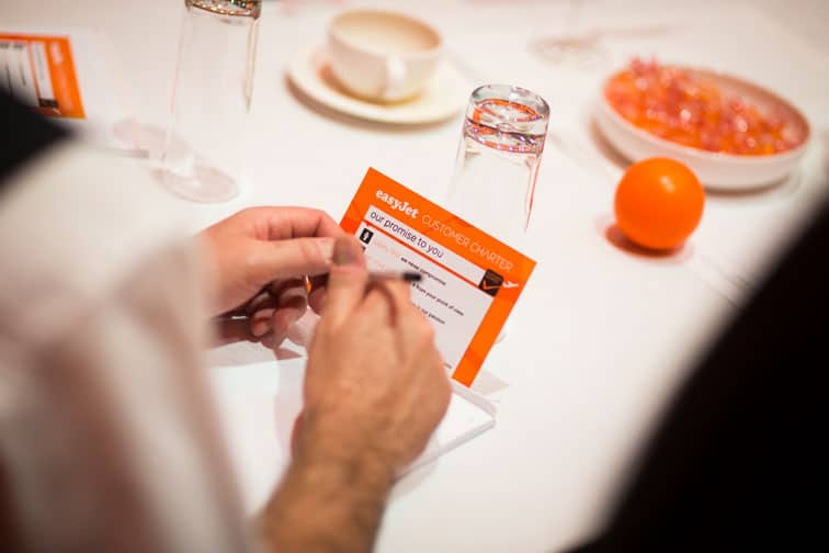 Colleague reading easyJet customer charter card
